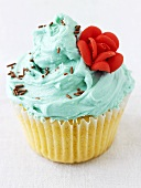Cupcake with turquoise icing and sugar rose