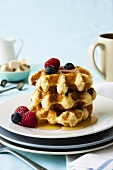 Belgian waffles with maple syrup and berries