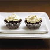 Two cupcakes on fabric napkin