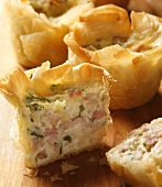 Gruyère and smoked ham in filo pastry shells