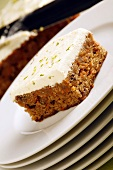 A piece of carrot cake with lemon frosting