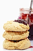 Three coconut biscuits with jam