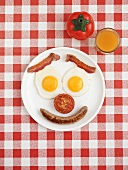 Bacon, egg, sausage and tomato for breakfast (smiley face)
