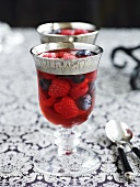 Berries in jelly in elegant glasses