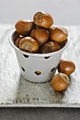 Hazelnuts in zinc pot