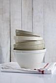 Stacked ceramic basins on tea towel