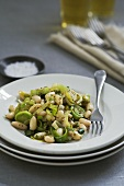 Leeks and cannellini beans with mustard sauce on plate
