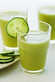 Three glasses of apple and cucumber juice