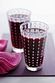 Two glasses of apple, blackberry and cucumber juice