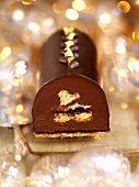 Chocolate truffle roulade with gold leaf (Christmas)
