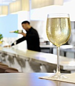 A glass of white wine in a restaurant
