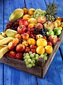 Fresh fruit and berries in a wooden crate