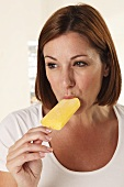 A woman eating an ice lolly