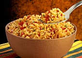 Tomato rice in a bowl and on a fork