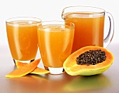Papaya juice in glasses and a glass jug