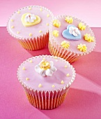 Fairy cakes with pink icing and sugar flowers