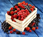 A wooden basket of fresh berries
