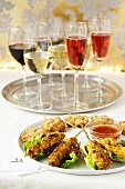 Kebabs and meatballs with a dip, wine and champagne