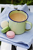 Earl Grey tea in an enamel mug with macaroons