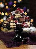 Various types of petit fours with redcurrants for Christmas dinner