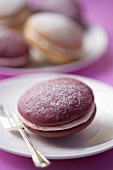 A berry whoopie pie with a dessert fork (close-up)