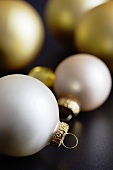 Ivory coloured and golden Christmas baubles
