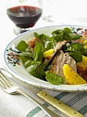 Roast duck breast with honey, oranges and water cress