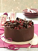 A chocolate cake with raspberries and chocolate curls