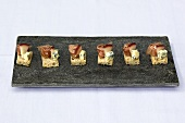 Canapes with Parma ham, apple and Stilton