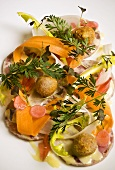Pork roulade with mustard sauce, dandelion and carrots