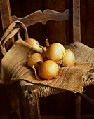 Onions on a wooden chair