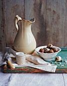An arrangement of salt, quail's eggs and a ceramic jug