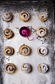 Mince pies with icing sugar and a Christmas bauble