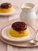 Sponge pudding with jam and vanilla sauce