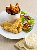 Breaded chicken fillets with sweet potatoes and a side salad