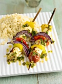 Vegetable kebabs with haloumi and couscous