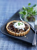 Goat's cheese and caramelised onion tartlet