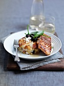 Atlantic salmon and potato cakes fried with maple syrup