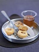 Homemade doughnuts with honey and salt
