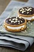 Moon pies (biscuits with a marshmallow filling) with chocolate icing, peanut butter and nuts
