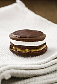 A double decker moon pie with a marshmallow filling, peanut butter and chocolate icing