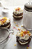 Chocolate whoopie pies with cream, icing sugar and sugar stars