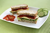 A cheese, gherkin and tomato sandwich