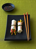 Rice paper rolls with vegetable filling and chili-soy dip