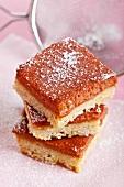 Rhubarb bars with powdered sugar, stacked