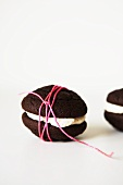 Chocolate Whoopie pie, wrapped with string