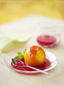 Peach cardinal (poached peaches with raspberry sauce)