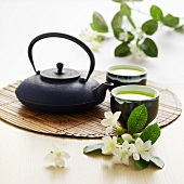 Ginseg and lime tea in bowls and a teapot