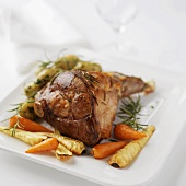 Roasted leg of lamb with rosemary and root vegetables