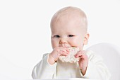 Baby eating a rice cracker